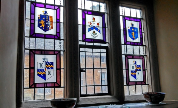 3 canon's ashby interior window with stained glass hangings